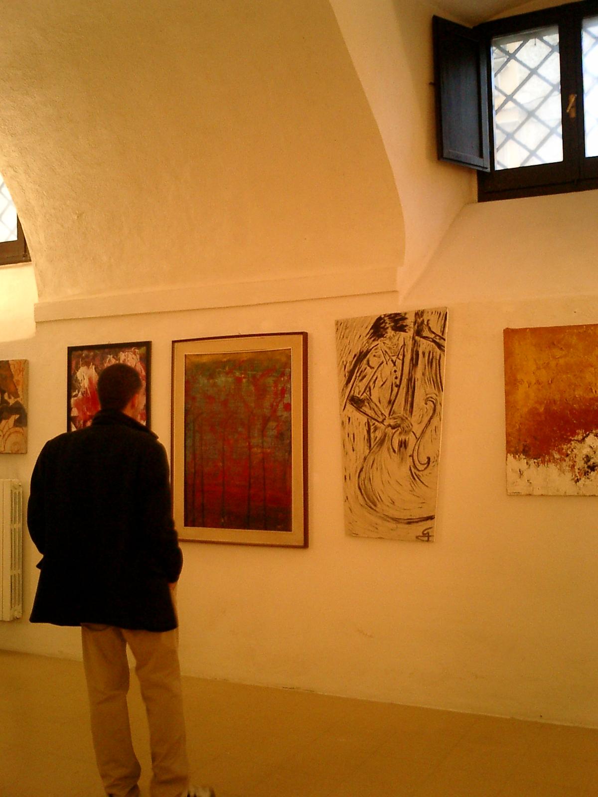 Nella foto alcuni momenti dell'incontro in occasione dell'inaugurazione della mostra